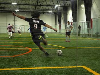 mens-futsol-goalie-kicking