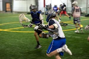 boys-lacrosse-runnng-up-sideline
